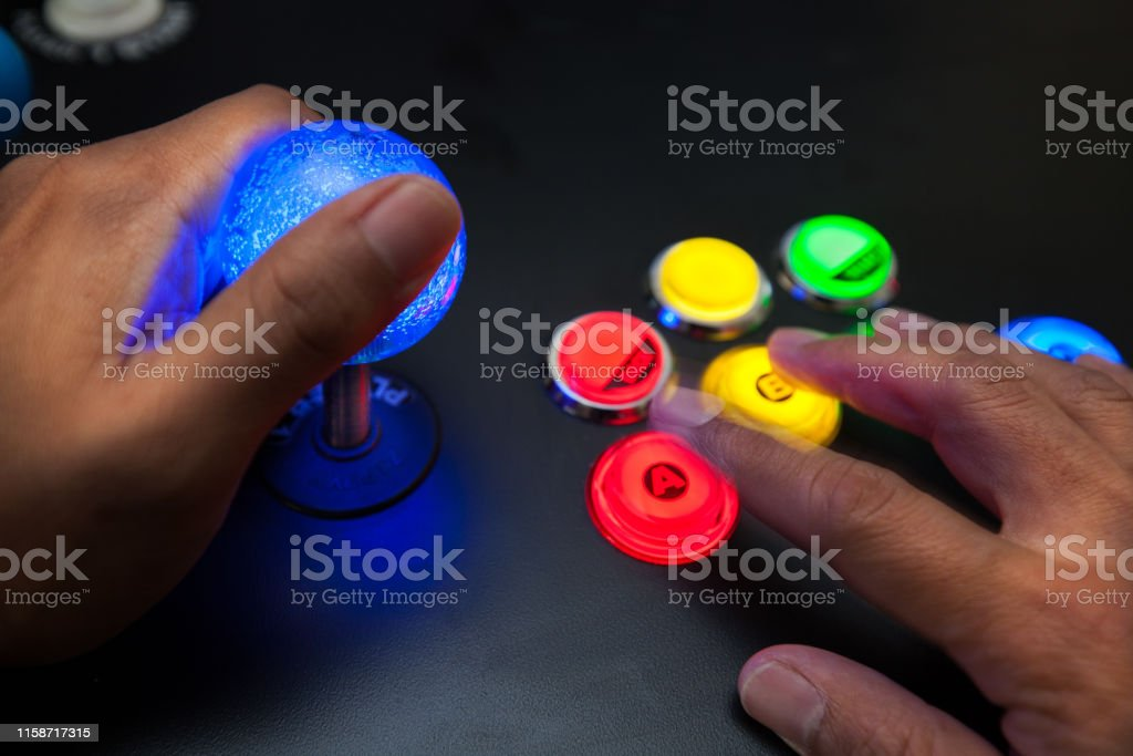 Arcade gamer using a lighted joystick and fighter button layout with...