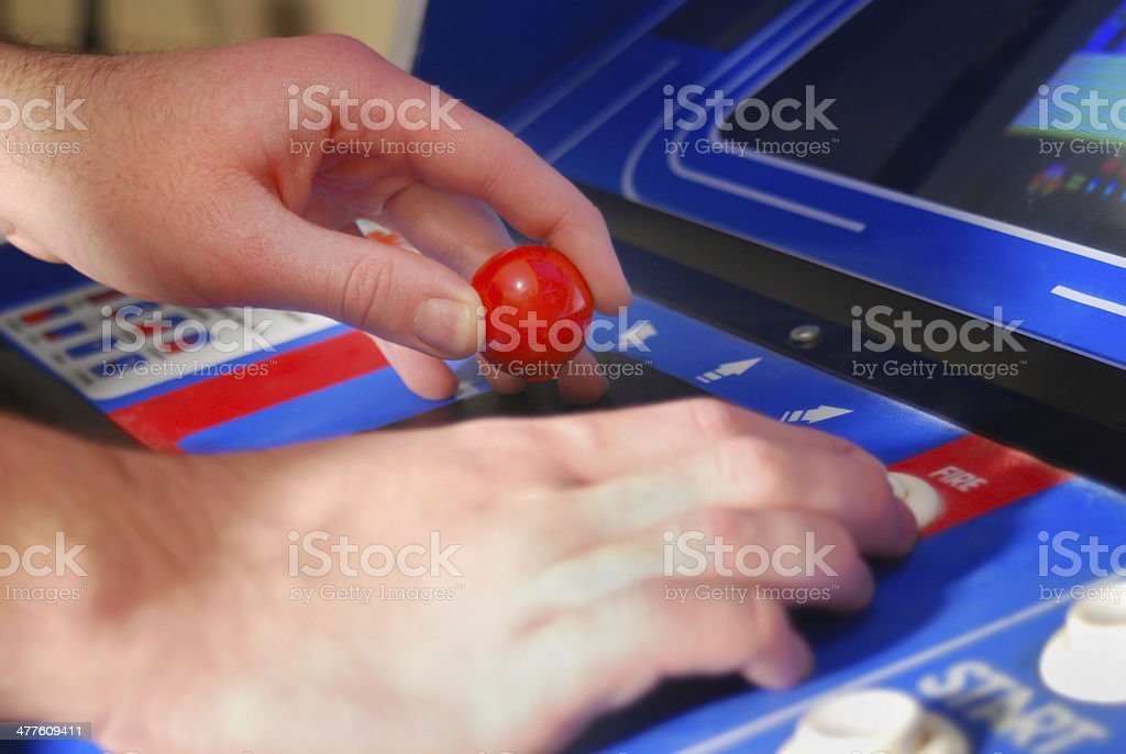 Arcade Machine with gamer's hands - close up stock photo