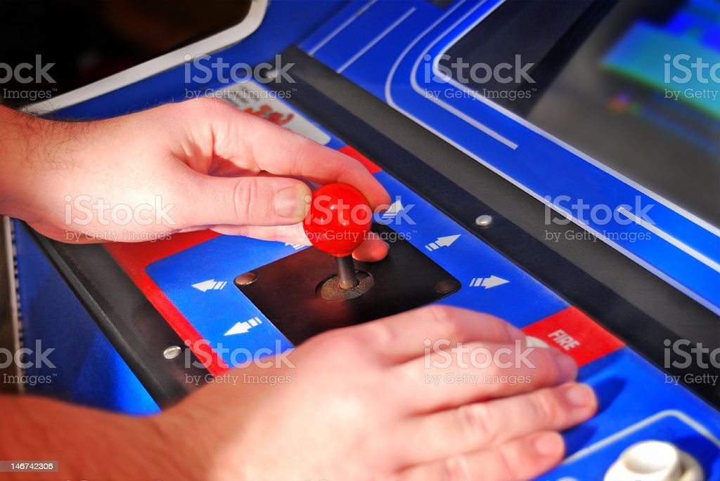Arcade Machine with gamer's hands royalty-free stock photo