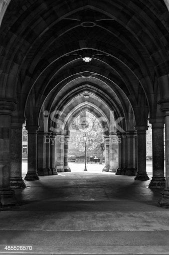 istock Arcades of old Glasgow University corridor cloisters. Scotland. Monochrome image. 485526570