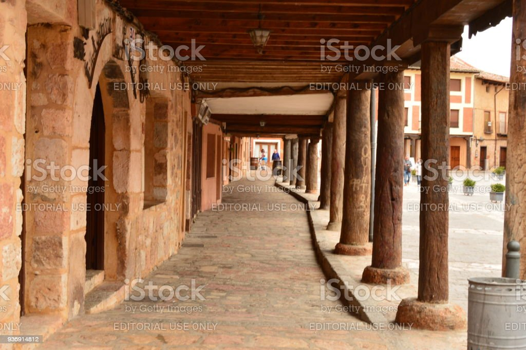 Arcads Of The Town Square Of Ayllon Cradle Of The Red Villages Besides Beautiful Medieval Town In Segovia. Architecture Landscapes Travel Rural Environment. stock photo