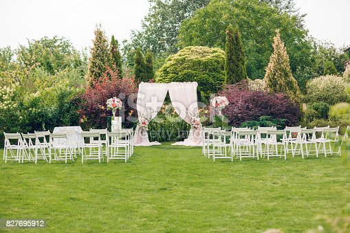 istock Arch and chairs for the wedding ceremony 827695912