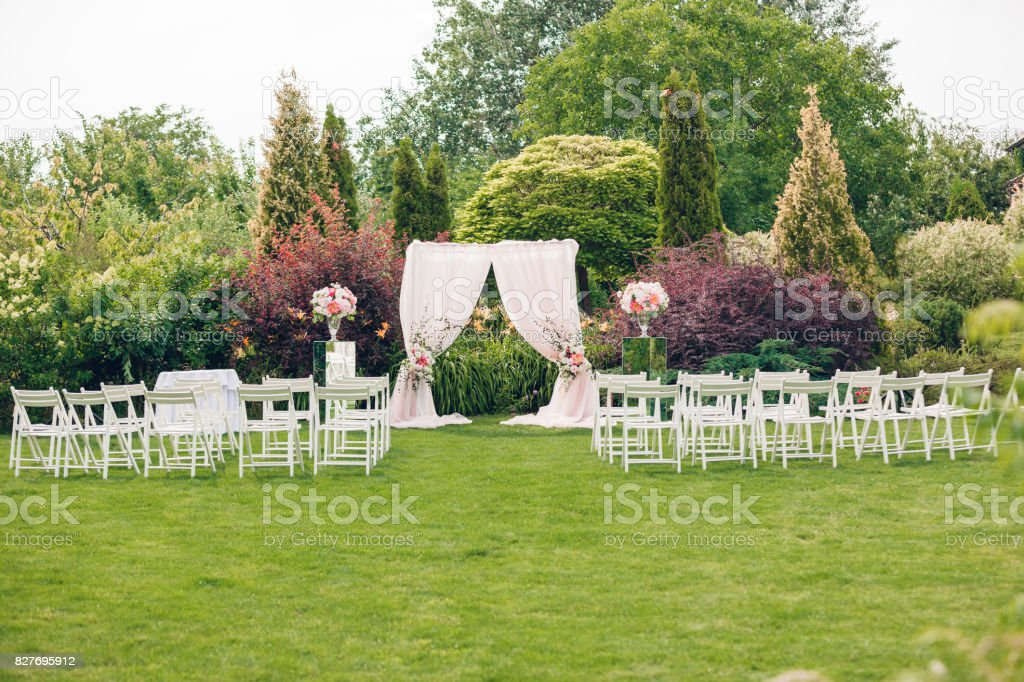 Arch and chairs for the wedding ceremony stock photo