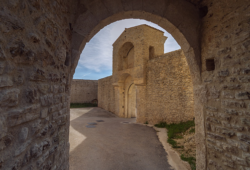 Arch and entrance to old medieval fortress (Rocca Albornoziana) in Spoleto, Umbria, Italy