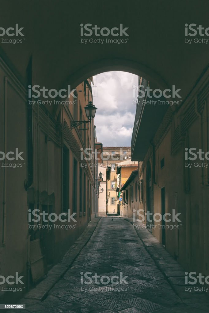 Arch between houses on a narrow street in Rome stock photo