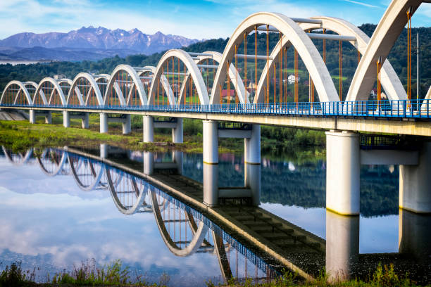 Arch Bridge on the rail road leading to the Tatra Mountains Arch Bridge on the rail road leading to the Tatra Mountains, Poland railway bridge stock pictures, royalty-free photos & images