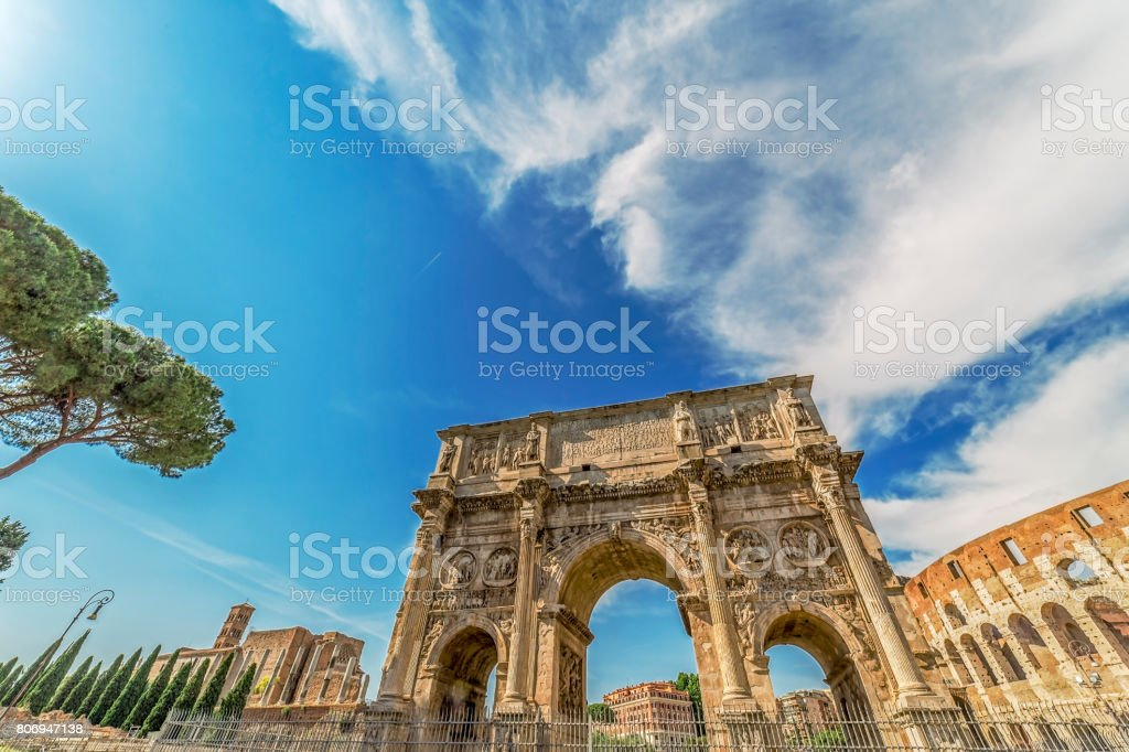 Arch of Constantine and Coliseum stock photo