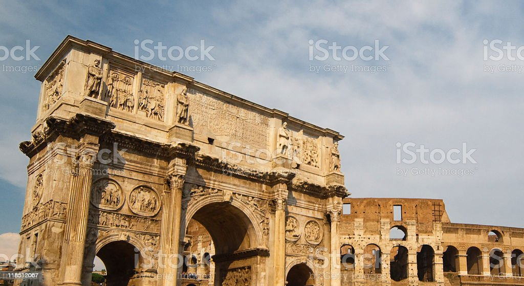 Arch of Constantine and Colosseum royalty-free stock photo