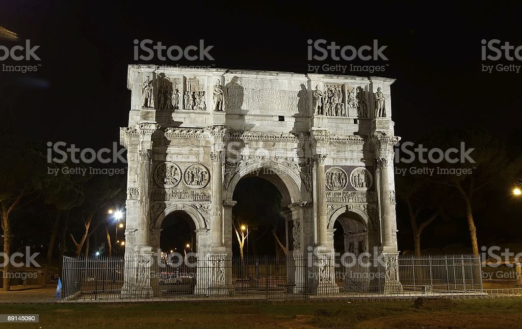 Arch of Constantine at night. stock photo