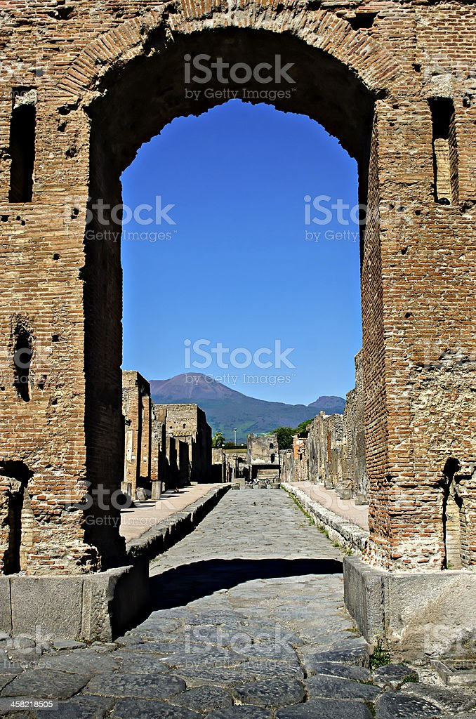 Arch of Emperor Nerone with Vesuvius in the background royalty-free stock photo