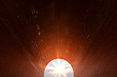 Arch of red brick. Sunlight at the end of tunnel. Symbol of hope, new life, search for goals and success.
