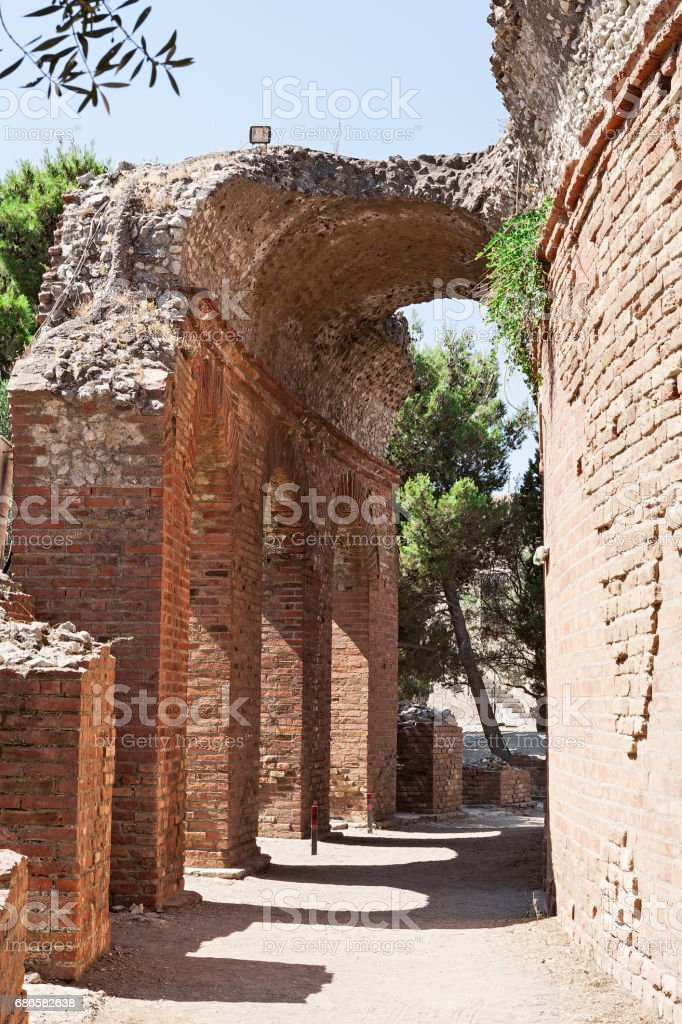 Arch of the ancient greek theater in Taormina, Sicily, Italy royalty-free stock photo