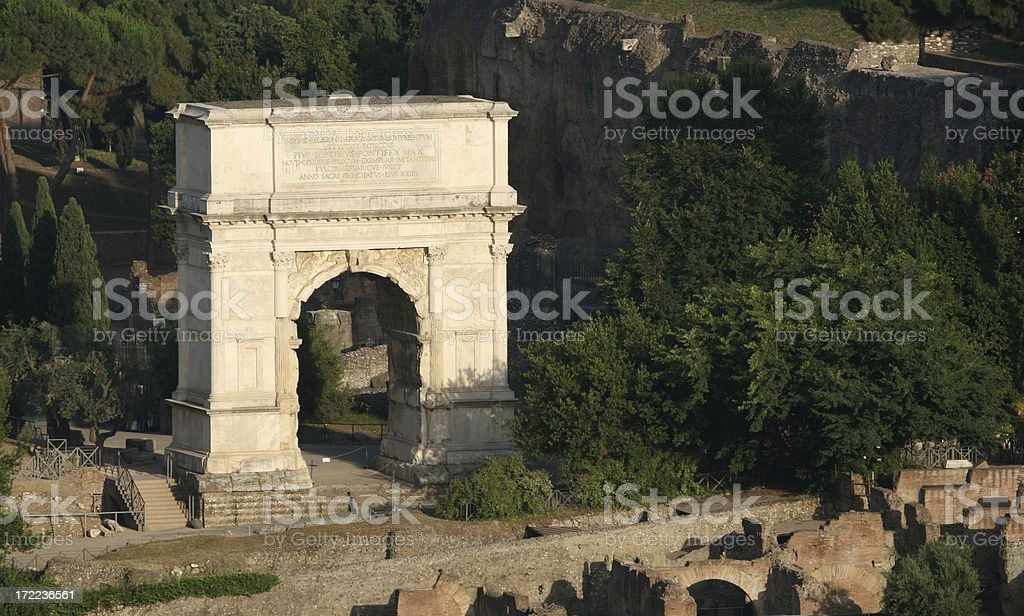 Arch of Titus at dusk stock photo