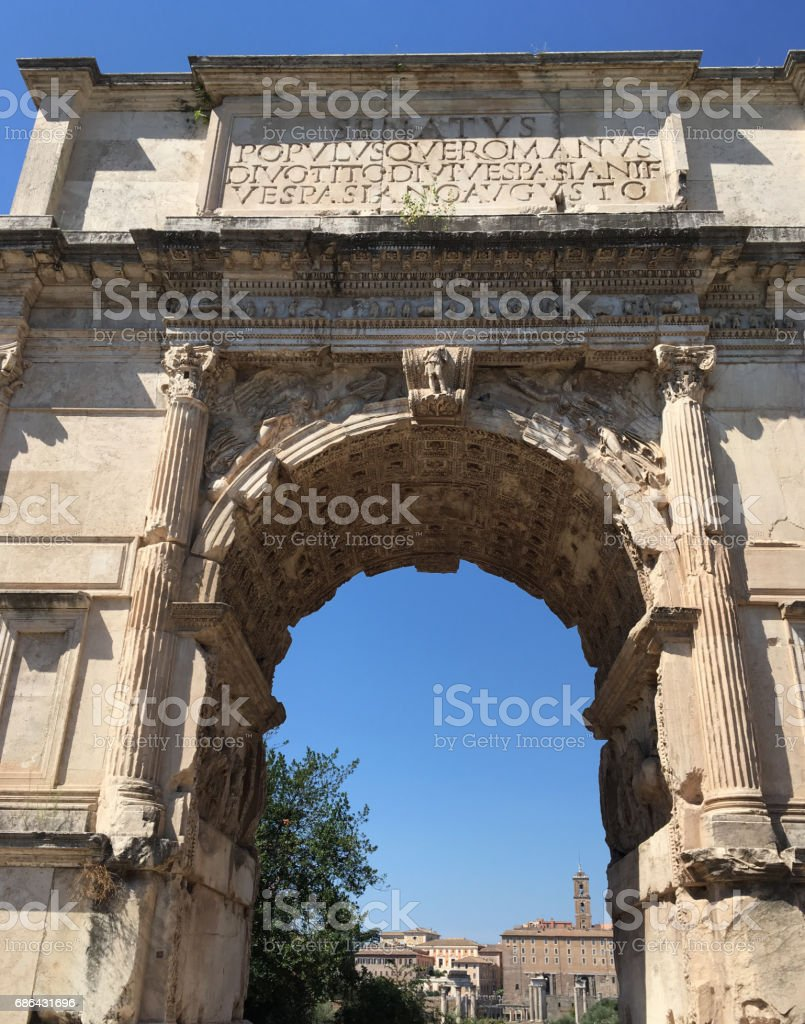 Arch of Titus (Arco di Tito), triumphal arch in the Roman Forum honouring the military victories of Emperor Titus, Rome Italy, near the Colosseum, on the Via Sacra.  Inspired the Arch de Triumph. stock photo
