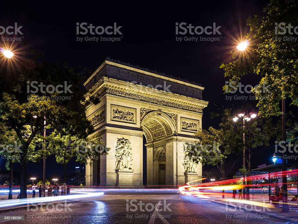 Arch of Triumph at night with light trails stock photo