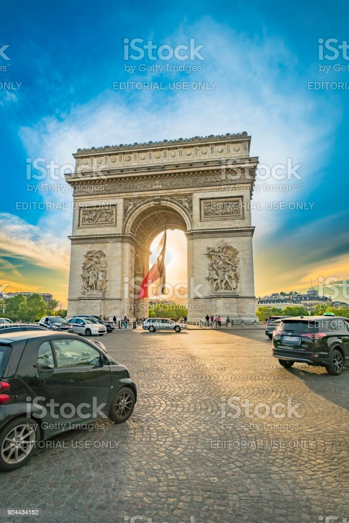 Arch of Triumph at sunset with Champs-Elysees roundabout traffic jam at rush hour, Paris, France stock photo