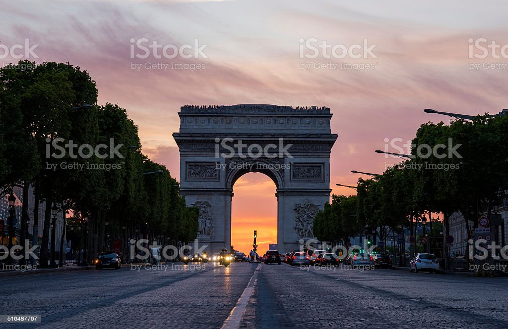 Arch of Triumph (Arc de Triomphe) with dramatic sunset behind stock photo