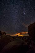 Stars at night behind Arch Rock Joshua Tree National Park