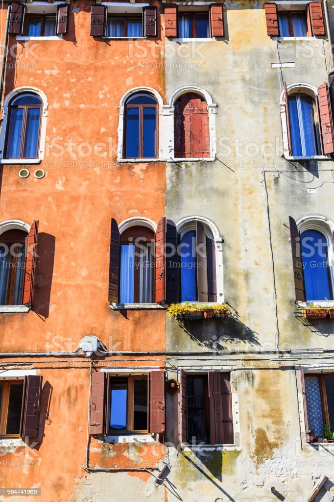 Arch shape windows on contrast color wall royalty-free stock photo