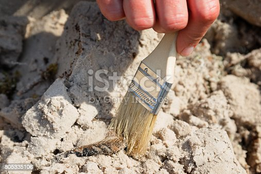 istock Archaeological discovery - a fragment of a ceramic vessel 805335106