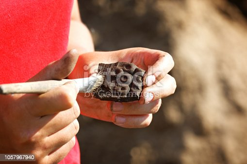 istock Archaeological find-part of a medieval broken clay vessel 1057967940