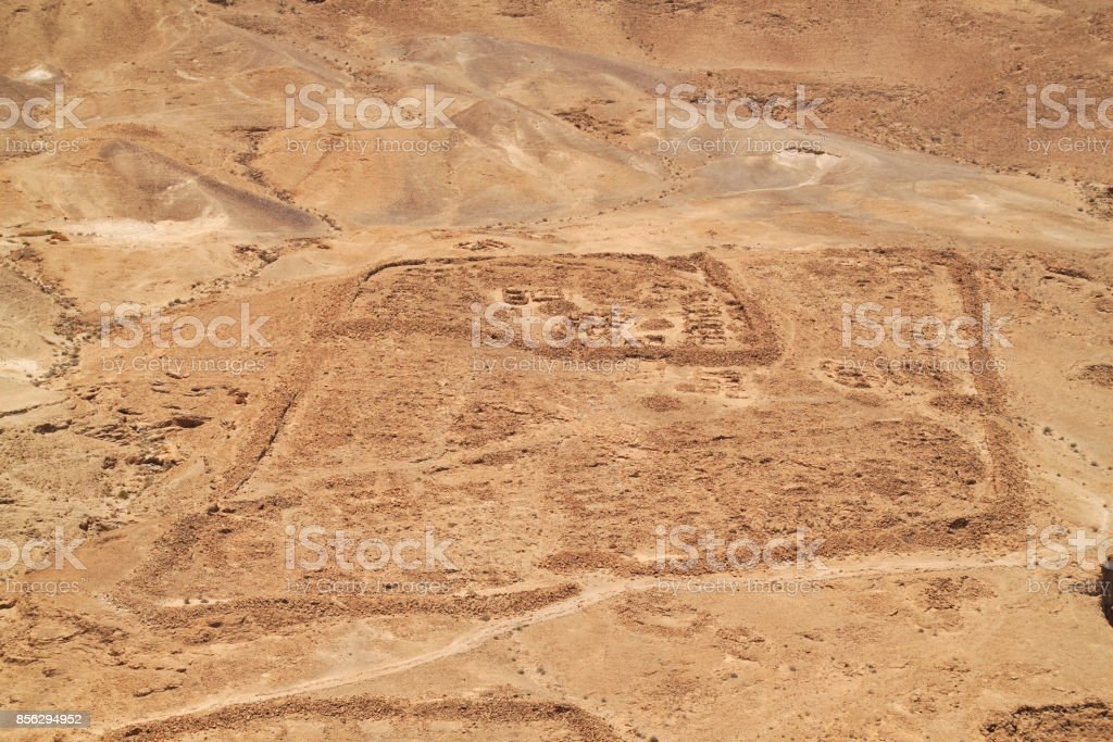 Archaeological ruins of a town at the base of the mountain of Masada stock photo