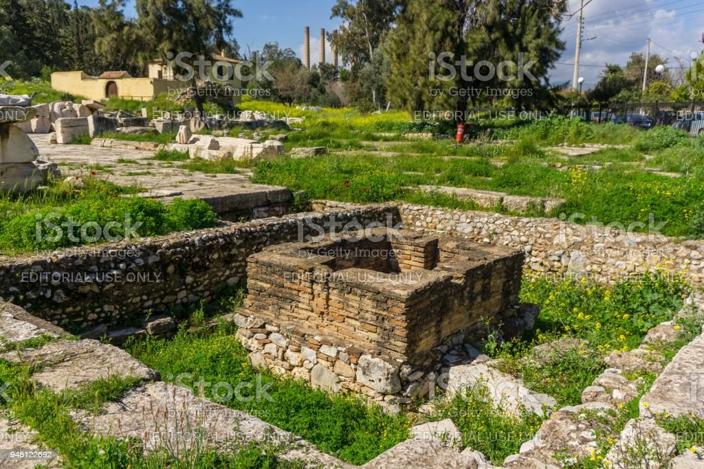 Archaeological site of Eleusis (Eleusina). The eschara in the Sacred Court, a structure (2nd B.C.), with altars for the offerings to the goddesses, and the temple of Artemis Propylaea stock photo