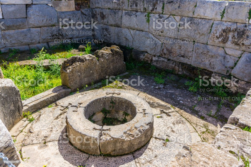 Archaeological site of Eleusis (Eleusina). Well of the fair dances (Callichoron Well) where godess Demeter rested, when she first came to Eleusis. stock photo