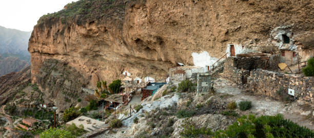 Archaeological site with cave houses on the cliff of Acusa Seca on the island of Gran Canaria, Spain stock photo