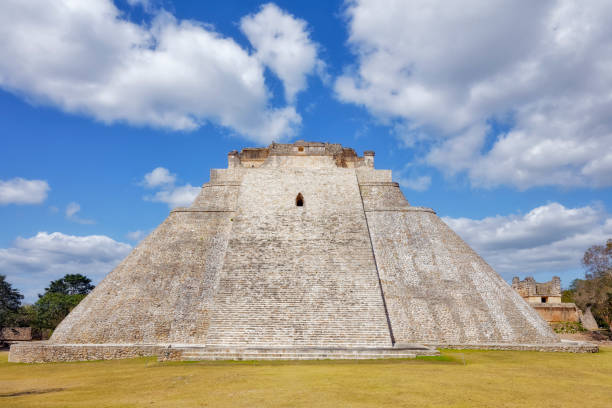 archaeological sites of pyramid of the magician in maya ruin complex of uxmal an mayan step pyramid ( muul waay - maya culture) in mexico - uxmal stock photos and pictures