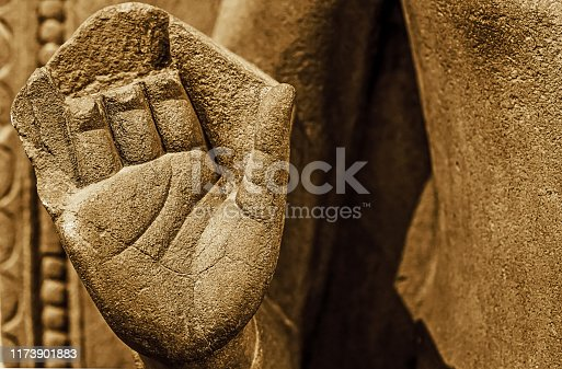Ancient archaeological stone sculpture of Gautam Buddha with close up view of broken hand