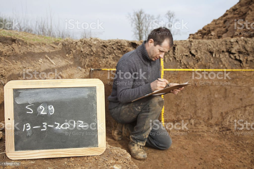 Archaeologist at excavation site stock photo