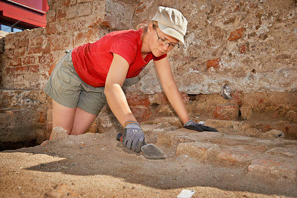 Archaeologist doing the job stock photo