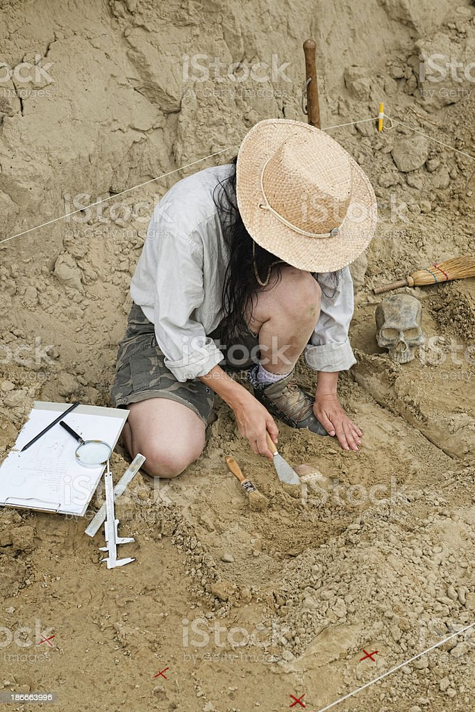 Archaeologist recovering ancient object stock photo