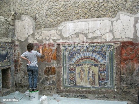 860524946 istock photo Archaeologist  Restoring Mosaic of Ercolano, Naples. 484013567