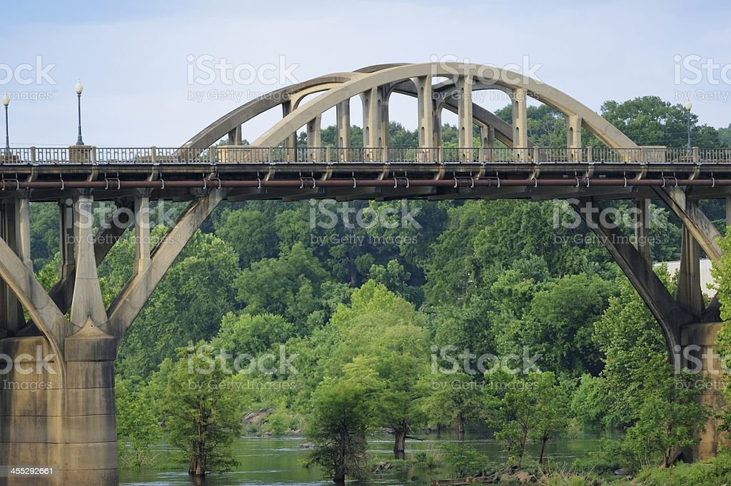 Arched bridge over river royalty-free stock photo