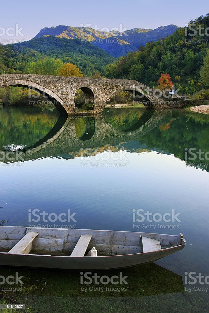 Arched bridge reflected in Crnojevica river, Montenegro stock photo
