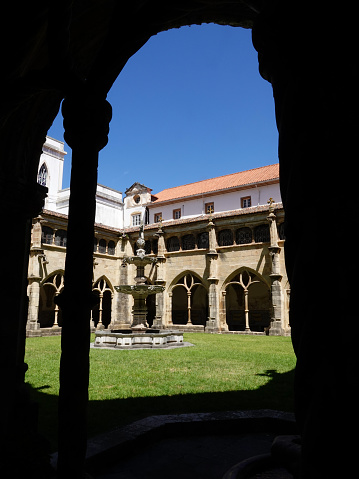 Silhouetted arch looking into the cloister of the Evora, Portagal Cathedral