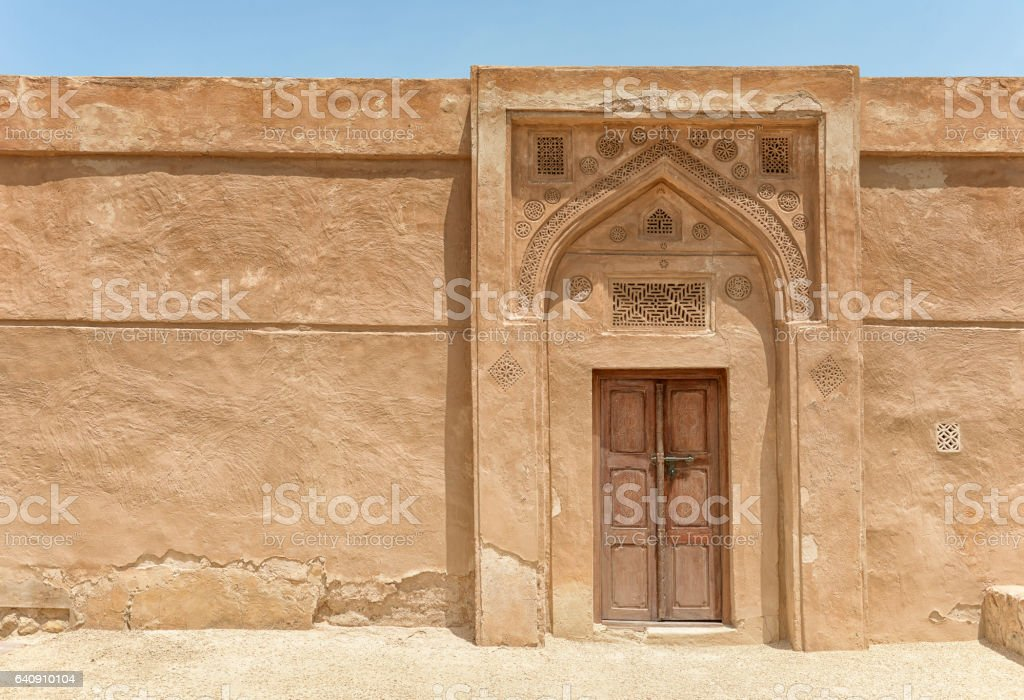 Arched doorway of an old Arabian fort stock photo