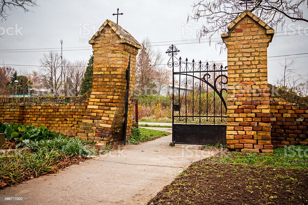 Arched gate with two pillars made of bricks stock photo