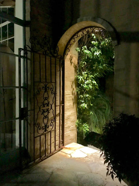 Arched gated entryway stock photo