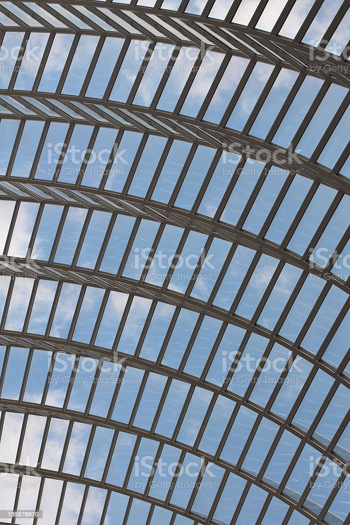 Arched glass roof with clouds stock photo