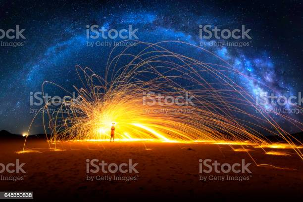 Photo of Arched Milky Way and Fiery Sparks on desert lake bed