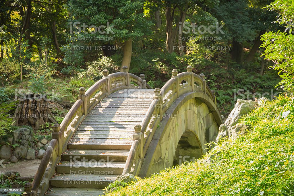 arched stone bridge in japanese garden koishikawa korakuen tokyo royalty free stock photo - Japanese Garden Stone Bridge