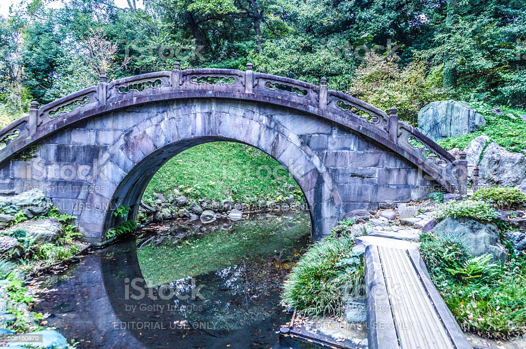 arched stone bridge in japanese garden royalty free stock photo - Japanese Garden Stone Bridge