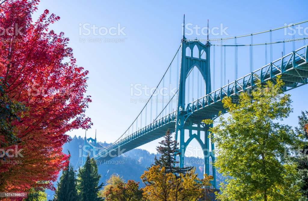Arched stylish St Johns bridge in Portland in the colors of autumn trees stock photo