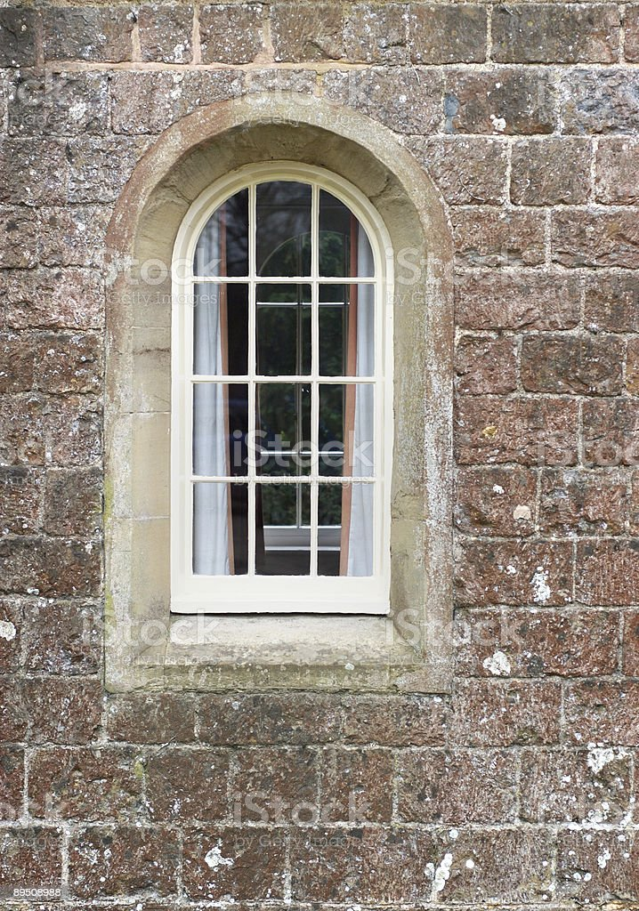 Arched window in a castle wall royalty-free stock photo