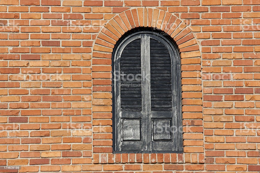 Arched Window on Bright Red Brick Wall, Building Exterior, Architectural royalty-free stock photo
