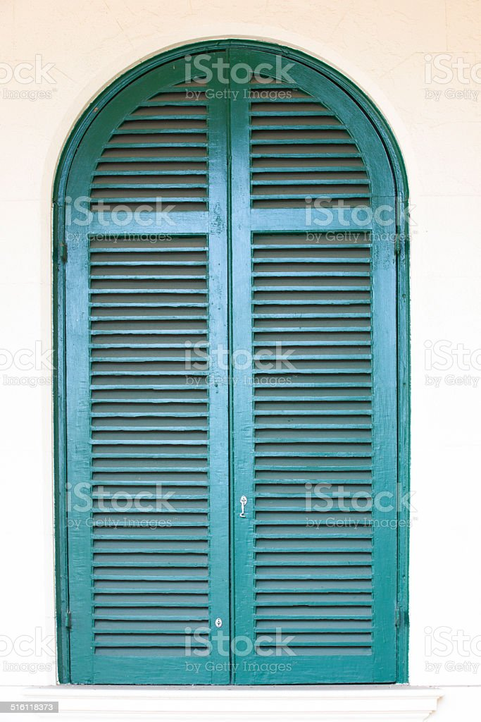 arched window shutters triangular window arched window with blue shutters royaltyfree stock photo window with stock photo more pictures of arch