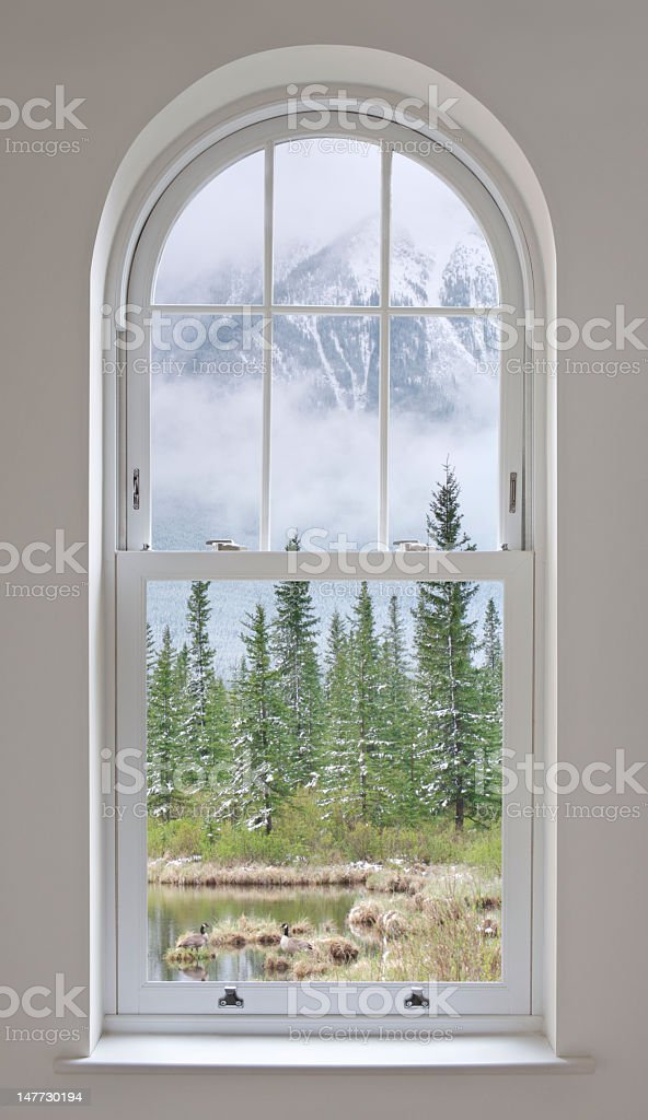 arched window with mountain views royalty-free stock photo